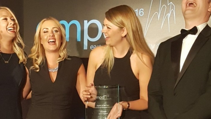 Laura Hibbs, Sian Cawthorne and Jenny Clarke collecting our award