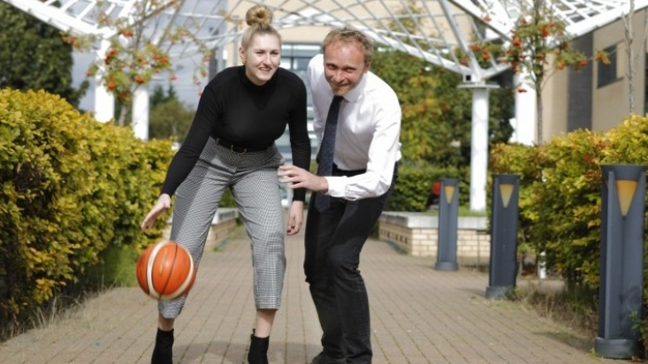 Team Captain of NTU's National League Women's Basketball team Vicky Gray and Head of Professional Services Steve Holland.