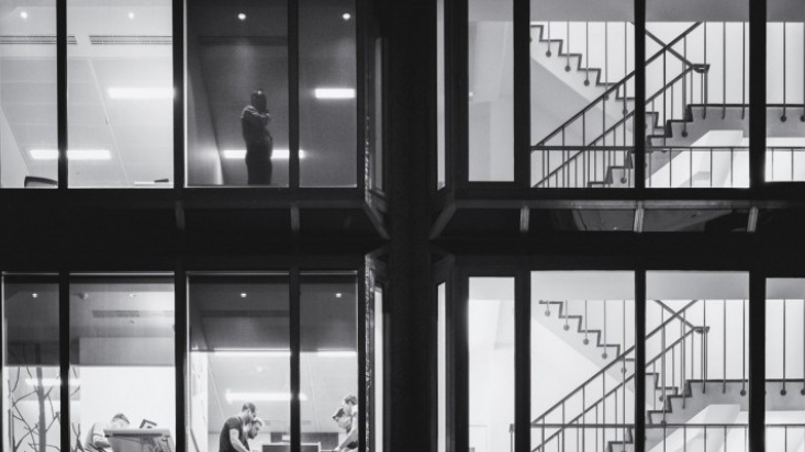 Various scenes in an office block showing people and staircases
